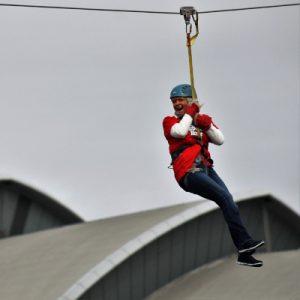 Woman on a zip slide